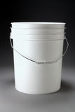 Five Gallon Pail. White five gallon pail with handle on gradated background Stock Photos