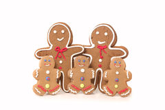 Five Gingerbread People Against a White Background Royalty Free Stock Images