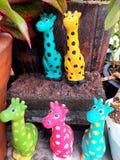 Giraffe stucco doll stock image