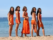 Five girls on the beach stock photos