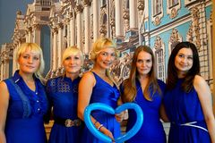 Five girls in blue dresses. stock photography