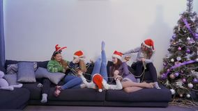 Five pretty girls have fun with each other at home, Christmas time stock footage