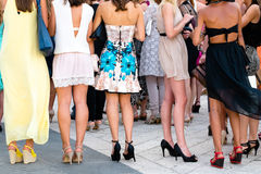 Five girls with nice legs. In cocktail dress Royalty Free Stock Image