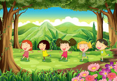Five girls playing in the middle of the forest Stock Photos