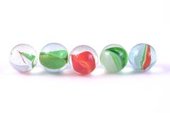 Five glass marbles Stock Photography
