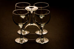 Five Glasses. On a dark background with one upside down Stock Images