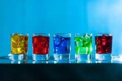 Five glasses with alcohol cocktail on the bar at Stock Image