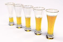 Five glasses with beer Royalty Free Stock Images