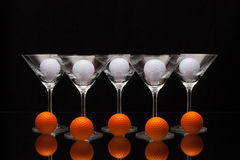 Five glasses of champagne and different golf balls Stock Images