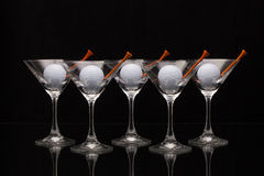 Five glasses of champagne and golf balls Royalty Free Stock Images