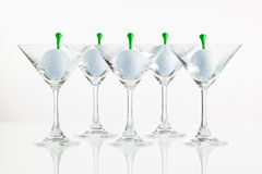 Five glasses of champagne and golf equipments Stock Images