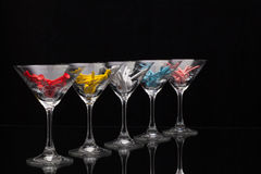 Five glasses of champagne and golf tees Stock Image