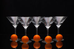 Five glasses of champagne and orange golf balls Stock Photo