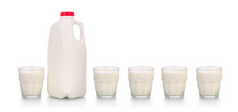 Five glasses of milk by plastic bottle on white Royalty Free Stock Image