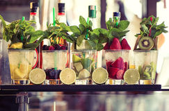 Five glasses of mojito with fruits. Fruit Alcoholic Cocktails royalty free stock photos