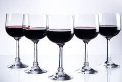 Five glasses of red wine. Or other beverage stock photography