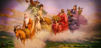 Guangzhou, China - July 10, 2018: A painting of five gods who came down to earth to help the people of Guangzhou and feed them. royalty free stock images