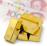 Five gold bars with china one hundred yuan background.  Royalty Free Stock Image