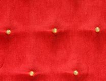 Five gold buttons on a red Brocade cushion belonged to the King Royalty Free Stock Images