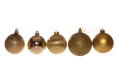 Five gold christmas tree baubles Stock Photo