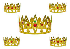 Five gold crowns. Photo of five gold crowns encrusted with precious gems Royalty Free Stock Photos