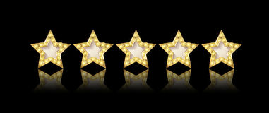 Five gold stars. With reflection on black background Royalty Free Stock Image