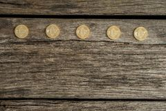 Five golden bitcoins in a row Stock Images