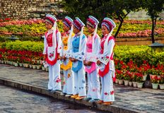 Five Golden Flowers(Chinese bai nationality people). Taken in the south gate of the Ancient city. Dali is located Yunnan of China Stock Images