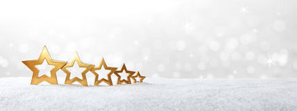 Five golden stars snow banner Royalty Free Stock Photography