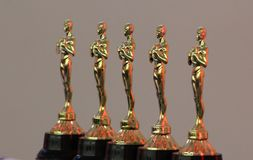 Golden trophies. Five Golden trophies ready to prize Royalty Free Stock Image