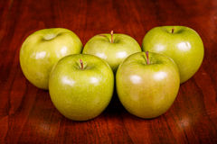 Five Granny Smith Apples on Table Royalty Free Stock Photo