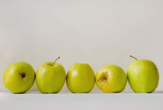 Five green apples. On a gray background Stock Photography