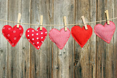 Five hand-sewn hearts Stock Images