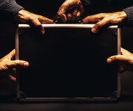 Five Hands on a Suitcase Royalty Free Stock Images