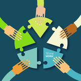 Five hands together team work. Hands putting circle puzzle pieces. Teamwork and business concept. Hands of different colors, cultural and ethnic diversity Royalty Free Stock Photography