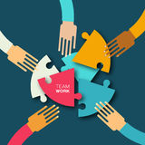 Five hands together team work. Hands putting circle puzzle pieces. Teamwork and business concept. Hands of different colors, cultural and ethnic diversity Royalty Free Stock Image