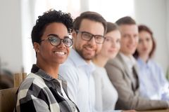 Happy multiracial team smiling looking at camera royalty free stock image