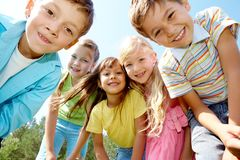 Five happy kids. Portrait of happy kids outdoor looking at camera Royalty Free Stock Photo