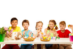 Five happy kids painting Eastern eggs together Stock Photography