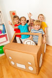 Five happy little friends playing drivers. Five happy little friends, boys and girls, playing drivers with handmade cardboard car inside Stock Images
