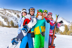 Five happy smiling friends with snowboards Stock Photo