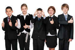 Five happy students hold his thumbs up Royalty Free Stock Photo