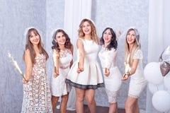 Five happy stylish young women celebrating Stock Image