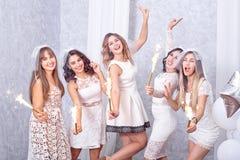 Five happy stylish young women celebrating Stock Images