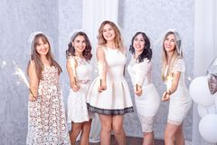 Five happy stylish young women celebrating Royalty Free Stock Images