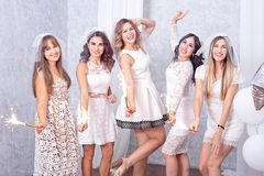 Five happy stylish young women celebrating Stock Photography