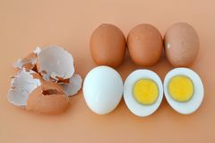 Five hard boiled brown chicken eggs on a brown background stock image