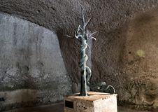 Five Headed Hydra bronze statue in the great gymnasium in Parco Archeologico di Ercolano. Pictured is a bronze five-headed hydra statue in the Great Gymnasium in Royalty Free Stock Photo