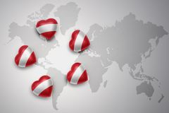 Five hearts with national flag of austria on a world map background. Concept.3D illustration Stock Images