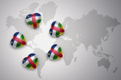 Five hearts with national flag of central african republic on a world map background Stock Photography